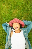 Portrait of woman laying in grass