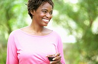 Woman laughing and drinking wine