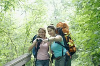 Young women hiking together in a forest