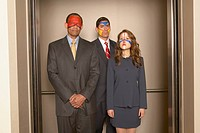 Group portrait of business people wearing face paint