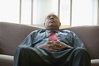 Businessman resting on couch