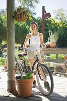 Woman with bicycle outdoors