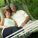 A couple relaxes in a hammock