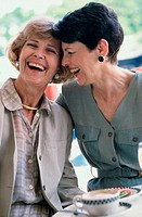 Two mature women laughing