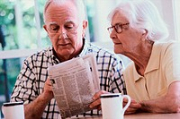 Senior couple reading a newspaper