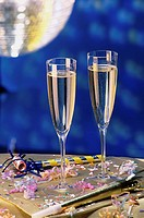 Close-up of two champagne flutes on a table