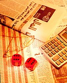 Arab newspaper, dices and calculator