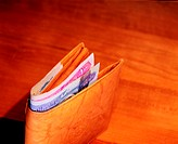 Wallet with Dirham notes sticking out (thumbnail)