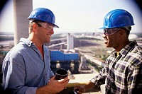 Two construction workers having a coffee break