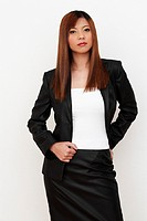 Studio shot of a lady with dyed hair in office attire.