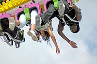 People on local carnival rides for fun during summer vacations at Florida State Fair US