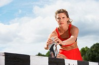 Athlete Doing Stretches on a Hurdle