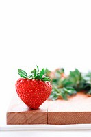 Strawberry on wooden board, close-up