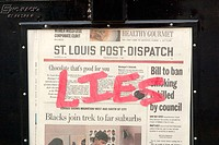 Graffiti marks a newspaper stand with the label 'Lies'. St. Louis Post-Dispatch daily paper. USA