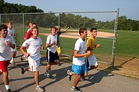 Runners warming up for track practice