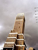 Kane Office Tower on 7th Avenue in New York City. The building is tilted against a cloudy sky. Picture has a painter like quality about it. USA