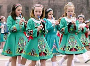 Abby Fronick, front, and Molly Krippene, right, play Irish tin whistles in a band marching in the St. Patrick's Day parade in St. Louis, Missouri. USA...