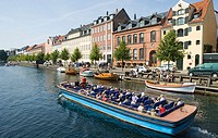 Tour boat on Christianshavns canal, Copenhagen, Denmark