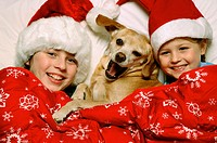 12 year old boy, 7 year girl and the family pet, a Beagle mix are all wrapped up in Christmas spirit.
