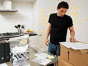 Man with office in the kitchen