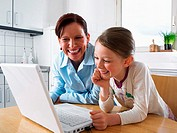Mother and daughter using laptop computer (thumbnail)