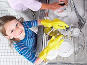 Girl helping with washing up (thumbnail)