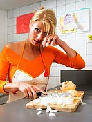 Woman chopping onions and crying