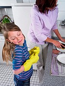 Girl and mother washing up