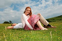 Couple resting in a field
