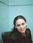 Woman sitting in office chair, portrait