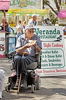 People confined to wheelchairs and walkers at the Florida State Fair grounds Seniors