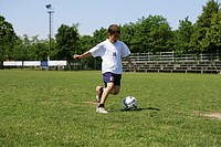 Young boy kicking a soccer ball