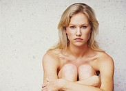 Portrait of Nude Blonde Woman Sitting