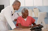 Medical team using desktop computer.