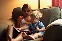 Kids reading on a chair