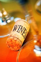 High angle view of a cork with wine glasses