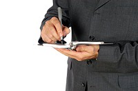 Mid section view of a businessman writing on a spiral notepad