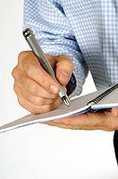 Close-up of a businessman writing in a notebook