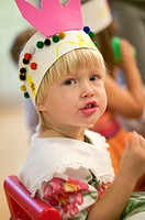 3 year old Caucasian girl at birthday party