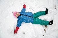 3 year old making snow angel
