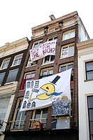House occupation with protest posters on the facade, Amsterdam. Netherlands