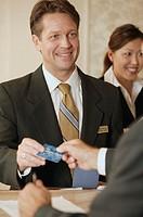 Businessman taking credit card.