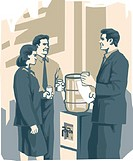 Office workers talking by water cooler