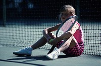 Young Girl Relaxing after Tennis
