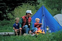 Father and Sons Roasting Marshmallows