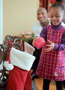 Girl Holding a Christmas Stocking Present