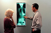 Chiropractor and Patient Looking at an X-Ray