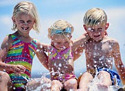 Children Splashing Water