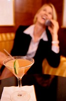 Cocktail with Businesswoman in Background