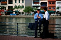 Businessmen Talking Near River, Singapore